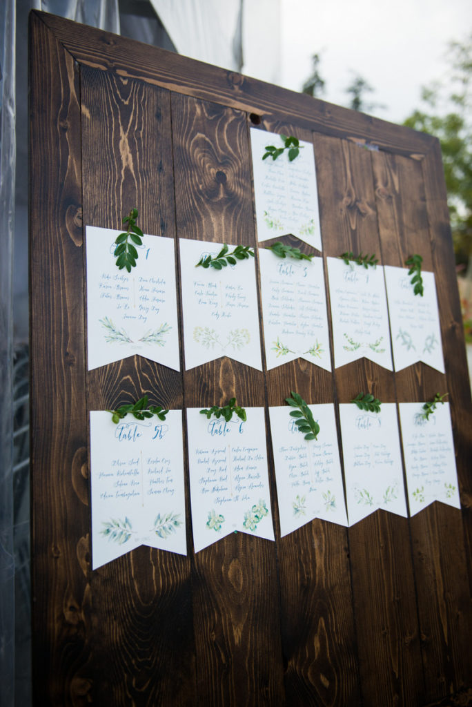 wood seating chart with herb greens