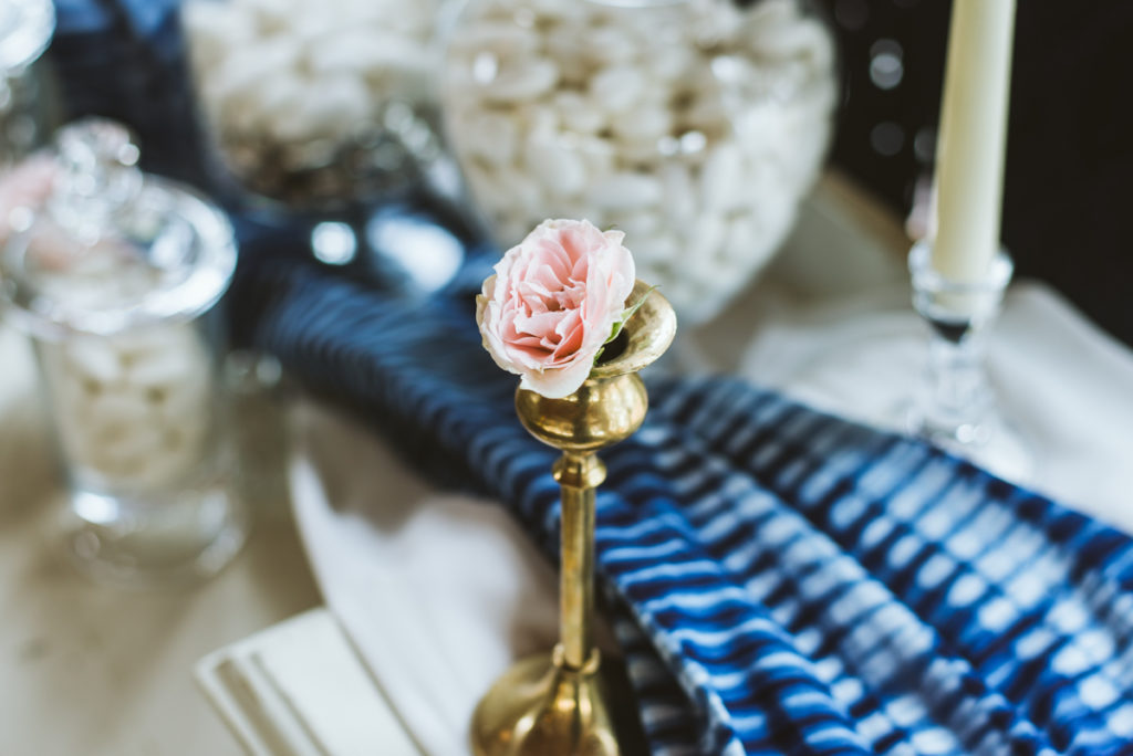 gold taper candle with blush rose