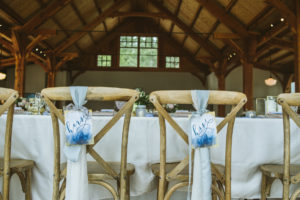 crossback chairs with mr and mrs sign