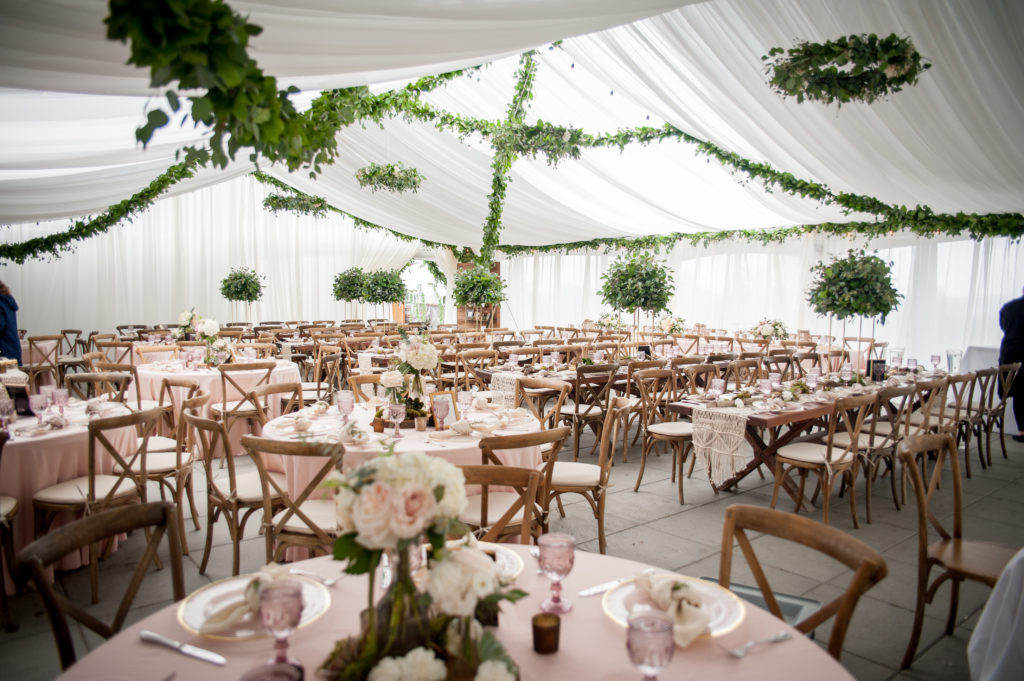 full room drape with hanging greenery seacider